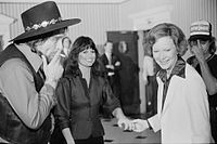 Waylon Jennings, Jessi Colter, and First Lady Rosalynn Carter at a reception preceding a concert to benefit the Carter-Mondale campaign on April 23, 1980.