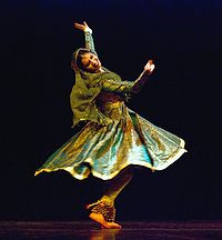 A dancer posing during a kathak dance sequence. The dance has its origins in Northern India and especially Lucknow.