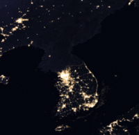 Satellite image of the Korean peninsula taken at night showing the extent of the division between the Koreas; note the difference in light emitted between the two countries