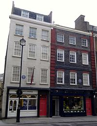 The white building (left) is 23 Brook Street; the building on the right is the Handel House Museum.