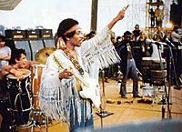 """Hendrix flashed a peace sign at the start of his performance of """"The Star-Spangled Banner"""" at Woodstock, August 18, 1969."""