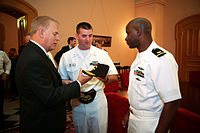 Sailors present Strickland with an honorary commander's cap during Navy Week, 2009.