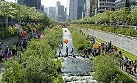 Cheonggyecheon river is a modern public recreation space in downtown Seoul.