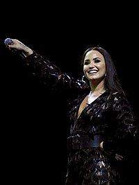 Lovato performing in Glasgow, Scotland on her Tell Me You Love Me World Tour in June 2018