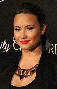 Lovato at the Redlight Traffic's Inaugural Dignity Gala in October 2013