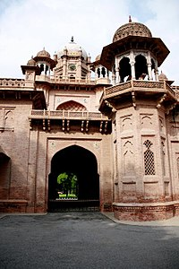 Aitchison College in Lahore with domed chhatris, jalis, chhajja below the balcony, and other features, reflective of Rajasthani architecture.