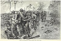 The Confederate troops behind the stone wall