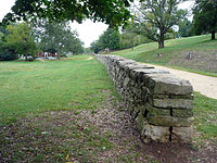 The sunken road at Marye's Heights in 2010. Approximately 3,000 Georgians under Thomas R. R. Cobb were lined up in multiple ranks behind the stone wall, and another 3,000 were atop the slope behind it, along with their artillery.