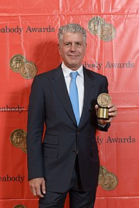 Bourdain with his Peabody Award in 2014