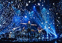 Coldplay performing in 2014 during the Ghost Stories Tour