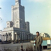 A tourist standing beside the iconic Palace of Culture and Science, 1965