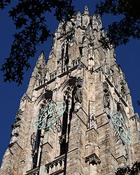 The bronze clock on Harkness Tower at Yale University, a structure reflecting the Collegiate Gothic architectural genre