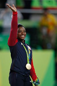 Biles at the 2016 Olympics all-around gold medal podium