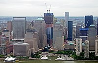 One World Trade Center under construction behind the World Financial Center in June 2011.