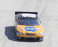 Kyle Busch (car shown above) is tied with Kevin Harvick for the second most wins during the season with four