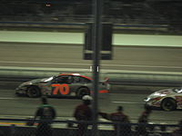 Mark Green (#70) leads Greg Biffle (#16) down pit road during a caution in the 2007 Ford 300 at the Homestead-Miami Speedway.