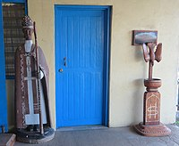 Wooden religious objects in front of All Saints' Church, Honiara