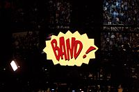 Final frame of cartoon-style E! – Street! – Band! video screen sequence at the end of Magic Tour shows.
