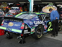 Brian Vickers' car with decals of the ten people killed in the Hendrick plane crash