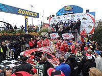 Harvick in victory lane with his team at the 2015 AAA 400
