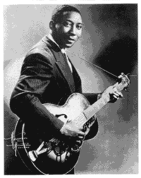 """Muddy Waters, described as """"the guiding light of the modern blues school"""""""