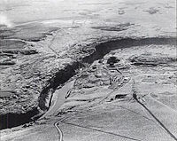 Glen Canyon damsite from the air in November 1957, prior to construction of the Glen Canyon Bridge