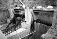 The right spillway gates during 1983 flood, showing flashboards that were installed to increase the water level