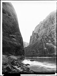 A boater on the river in Glen Canyon before damming, circa 1898.