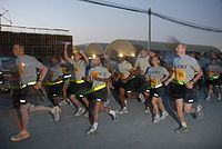 U.S. Army troops in 2009 passing by the starting point of the Army Ten-Miler run at their base next to Kandahar International Airport.