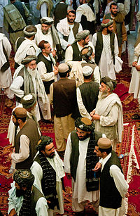 A gathering of tribal and religious leaders following a shura held by Afghan President Hamid Karzai in June 2010 to start a dialogue for peace with the Taliban.