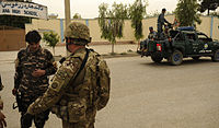 Afghan National Security Forces and members of ISAF providing security in 2012.