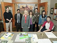 The cast of the first and second seasons Parks and Recreation included (from left to right), Paul Schneider, Aziz Ansari, Amy Poehler, Rashida Jones, Nick Offerman, Aubrey Plaza, and Chris Pratt.