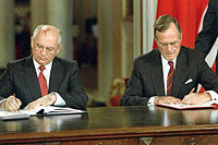 Mikhail Gorbachev and George H. W. Bush signing bilateral documents during Gorbachev's official visit to the United States in 1990