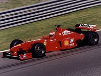 Schumacher's championship aspirations were ended by a leg-breaking accident in . Eddie Irvine (pictured) stepped up to lead the team and only lost the drivers' title to Mika Häkkinen by two points, while Ferrari won its first Constructors' Championship since
