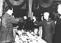 Chiang Kai-shek and Mao Zedong toasting together in 1946 following the end of World War II