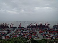 The Port of Shanghai's deep water harbor on Yangshan Island in the Hangzhou Bay is from 2010 the world's busiest container port