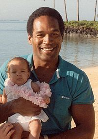 Simpson with his daughter, Sydney Brooke, in 1986