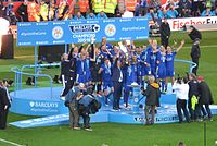 Leicester City players lifting the Premier League trophy after the 2015–16 season.