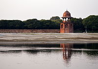 Remaining southeastern red sandstone corner tower of the enclosure at the river bank of the Mehtab Bagh, across the river from the Taj Mahal