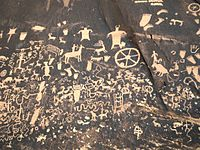 Newspaper Rock State Historic Monument, Utah, contains petroglyphs left by the first inhabitants of the American Southwest.