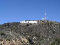 The Hollywood sign in the Hollywood Hills, has come to represent the American film industry.