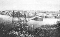 Watercolor of the first bridge erected across the Lehigh River in 1814, just north of the current bridge. The bridge, erected between 1812–1814 is shown looking west from the east bank of the river. This painting was made about 1830, after the opening of the Lehigh Canal. It also shows Dam Number 7 on the Lehigh River, now known as the Hamilton Street Dam.