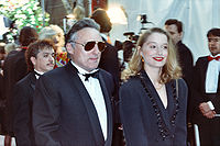 Hopper with Katherine LaNasa, his fourth wife, at the 62nd Academy Awards in 1990