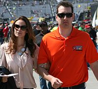 Busch and wife Samantha in April 2013