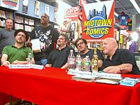 Writers of Marvel titles in the 2010s include (seated left to right) Ed Brubaker, Christos Gage, Matt Fraction, and Brian Michael Bendis.