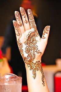 Mehndi is the application of henna as a temporary form of skin decoration, commonly applied during Eid al-Fitr.