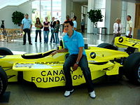 Rahal posing with a show car how he raced in Champ Car in 2007