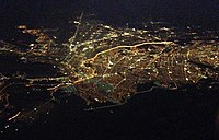 Aerial view of El Paso, Texas, (top and left) and Ciudad Juárez, Chihuahua, (bottom and right). The brightly lit border can clearly be seen as it divides the two cities at night. The dark section at left is where the border crosses Mount Cristo Rey, an unfenced rugged area.