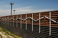 The wall at the border of Tijuana, Mexico and San Diego; the crosses represent migrants who have died in crossing attempts.