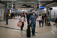 Flyers at Hartsfield-Jackson Atlanta International Airport wearing facemasks on March 6th, 2020 as the COVID-19 coronavirus spreads throughout the United States. Disproportionate numbers of cases have been observed among Black and Latino populations,